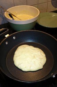 Apple pancake in the pan
